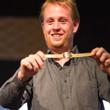 Michael Gathy displays his gold bracelet