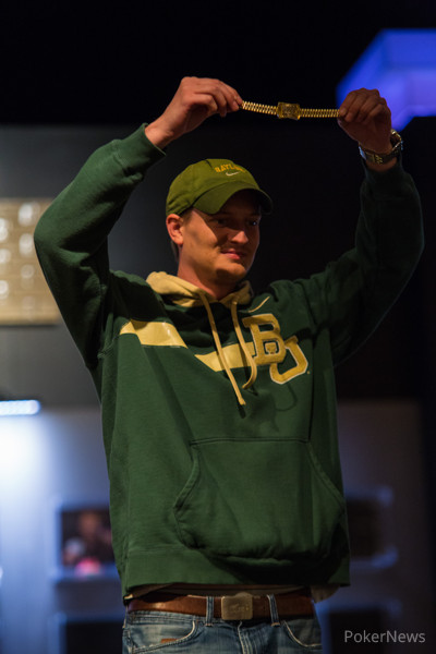 Jared Hamby holds his gold bracelet aloft