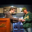 Jack Effel hands Jared Hamby his gold bracelet