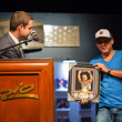 Brandon Wong receiving his framed photo