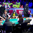"Phil Hellmuth  fist bumps"" JC Tran as he visits the secondary feature table."