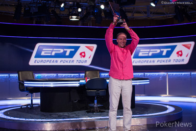 Vitaly Lunkin holds his €50k Super High Roller trophy aloft