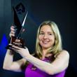 Victoria Coren holds her trophy aloft