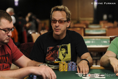 Phil Laak busted with top two.