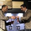 Jack Effel presents the gold bracelet to Nick Kost, winner of Event #14: $1,500 Limit Omaha Hi-Low