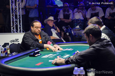 Doyle Brunson on the rail for his son Todd