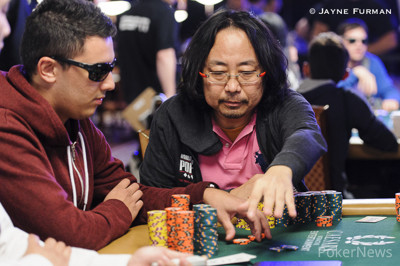 Dong Guo won a massive pot with aces.