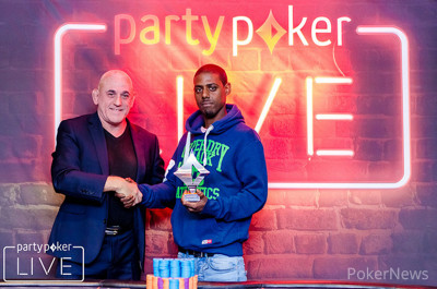 Leon Campbell collects the Side Event trophy from Dusk Till Dawn and poker legend Simon Trumper