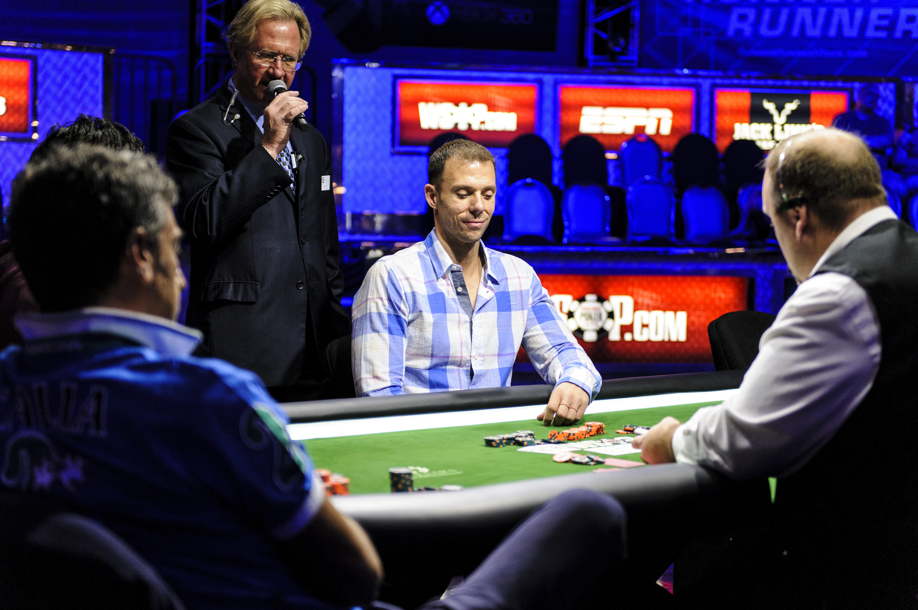 Matt Berkey smiles seeing the flop as he is all in vs Antonio Buonanno