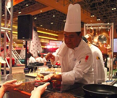 A chef serves up a sample from the Rio's Buzio's Seafood PokerPalooza branch location