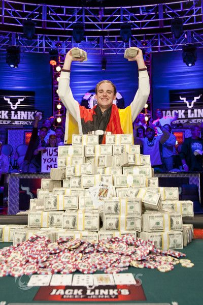 Pius Heinz and his pile of cash after winning the 2011 WSOP Main Event
