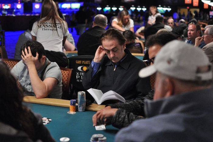 This gentleman was reading Mike Matusow's book in Event #24: $5,000 Omaha Hi-Lo Split 8-or-Better