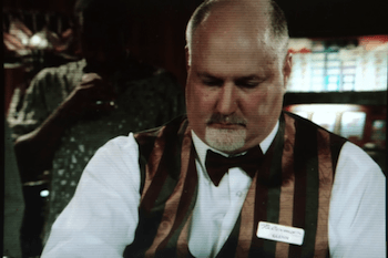 Tom Schneider as a dealer on CSI.