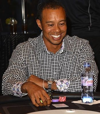 Tiger Woods playing poker. Image courtesy of The Sun.