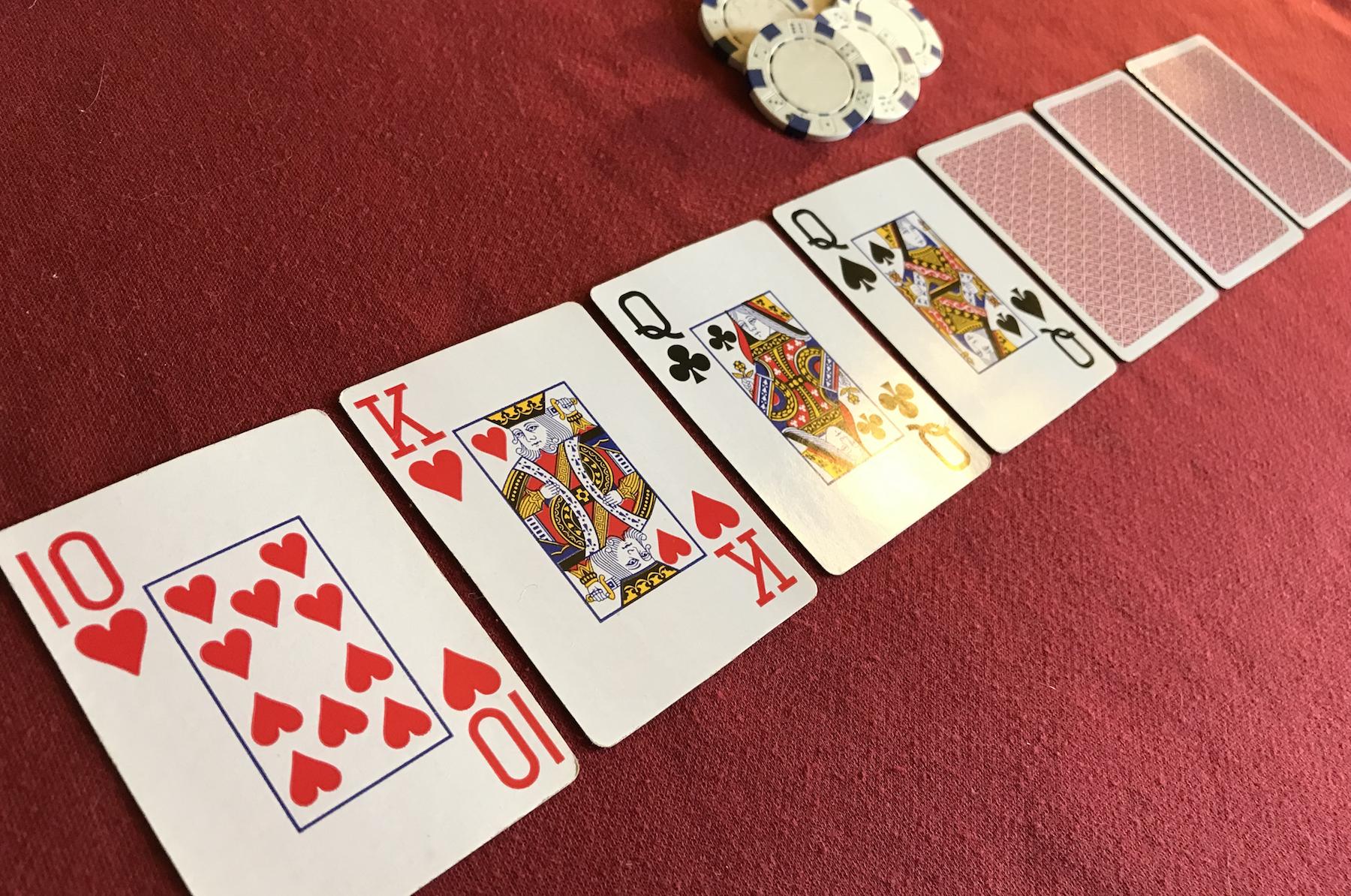 Seven card no peek poker game