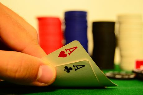 Playing Aces and Kings Early in a Multi-Table Tournament