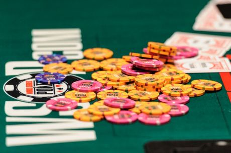 In Too Deep: A Big Pot With One Mediocre Pair Early in a Tournament