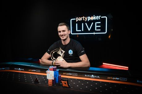 Steffen Sontheimer poses after his win in the CPP $250,000 Super High Roller Championships