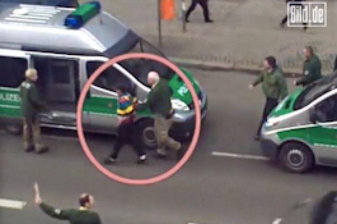 EPT røveren føres væk af tysk politi