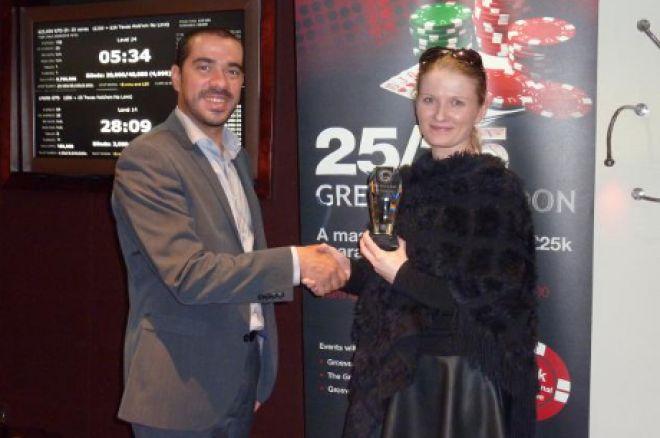 Elllie Biessek receives her trophy from the tournament director.