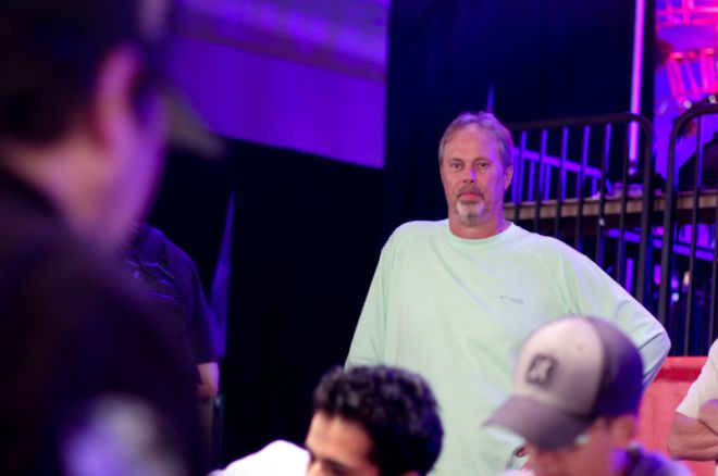Paul Gilbert watched Phil Hellmuth in the Amazon Room.