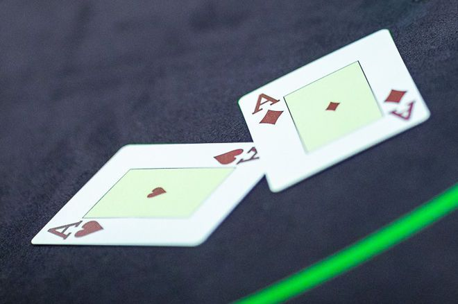 Call or Fold to a River Bet With Pocket Aces?