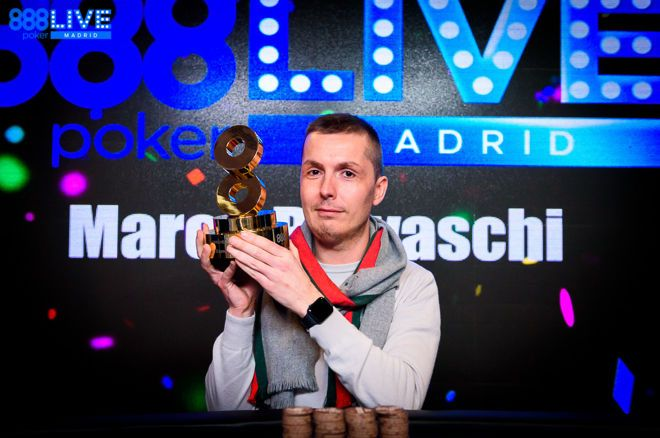 Marco Biavaschi wins 888poker LIVE Madrid Main Event; He lifts the trophy and smiles after securing victory