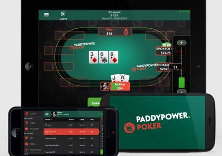 Poker players evaluate their poker cards after the flop is placed on the table in PaddyPower Poker app.